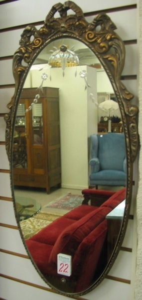 22: AN AMERICAN OVOID WALL MIRROR, c. 1930's, having a