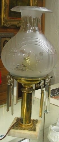 304: AN ELECTRIFIED TABLE LAMP, c. 1915. The embossed g