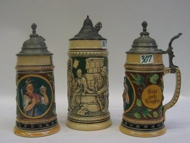 307: THREE GERMAN GLAZED POTTERY BEER STEINS, all  with