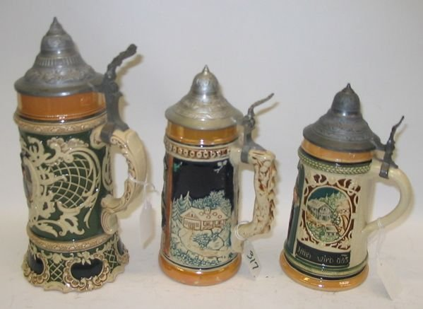317: A GROUP OF THREE GERMAN GLAZED POTTERY BEER  STEIN