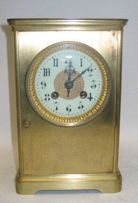 320: A GILT METAL CASED MANTEL CLOCK, time and  strike,