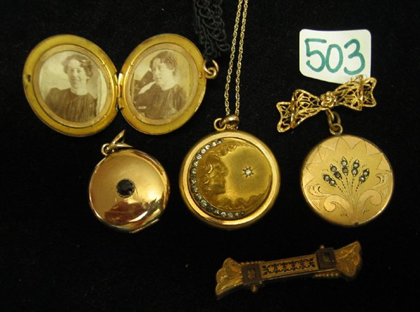 503: FOUR GOLD LOCKETS AND A GOLD PIN, two 14K yellow g