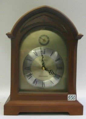 550: A WALNUT CASED LINDEN MANTEL CLOCK, with battery o