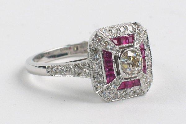 613: RUBY, DIAMOND AND EIGHTEEN KARAT WHITE GOLD  RING,