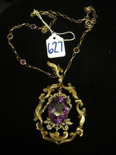 627: AMETHYST, DIAMOND AND NINE KARAT YELLOW GOLD  PEND