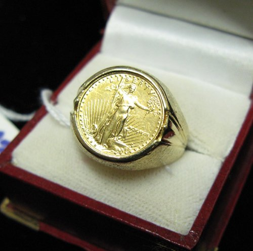 1002: MAN'S GOLD COIN AND FOURTEEN KARAT GOLD RING,  be