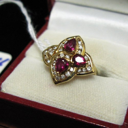 1004: RUBY, DIAMOND AND FOURTEEN KARAT GOLD RING.  The