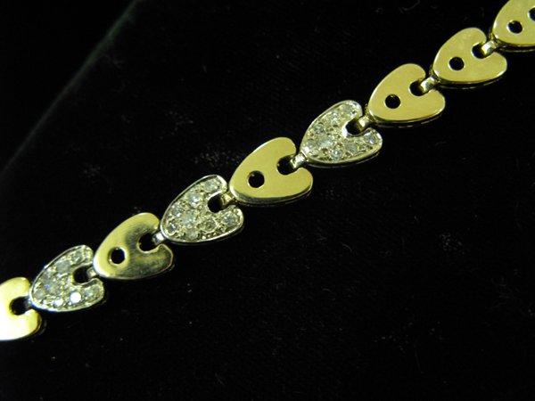 1015: DIAMOND AND FOURTEEN KARAT GOLD LINK BRACELET,  w