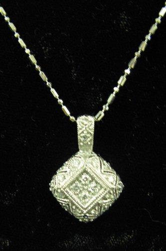 1019: DIAMOND AND FOURTEEN KARAT WHITE GOLD PENDANT  NE