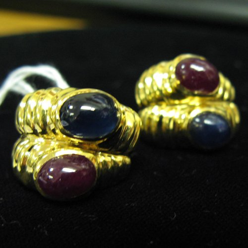 1126: A PAIR OF RUBY, SAPPHIRE AND FOURTEEN KARAT GOLD