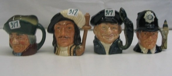 317: A GROUP OF FOUR GLAZED ROYAL DOULTON CHARACTER  MU