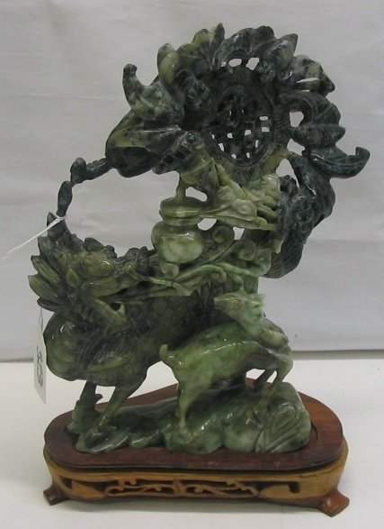 323: A CHINESE JADE FIGURAL GROUP, of a decorative  dis