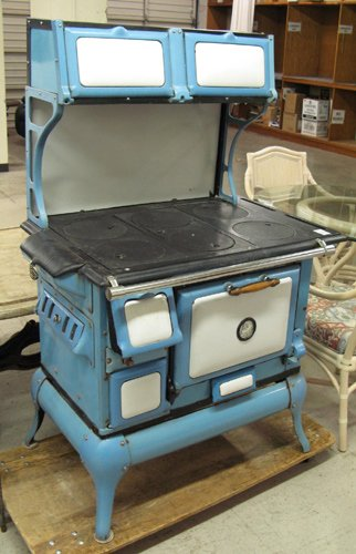375: A CAST IRON WOOD-BURNING COOK STOVE, Montgomery  W