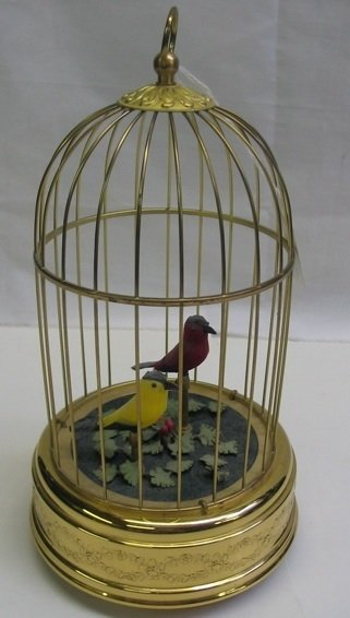 606: A SWISS MUSICAL AND MECHANICAL BIRD CAGE. The  red