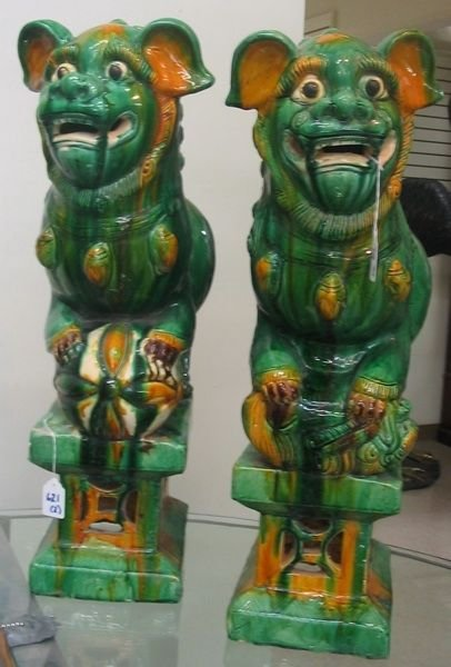 621: PAIR CHINESE GLAZED POTTERY FOO LION FIGURES on  a
