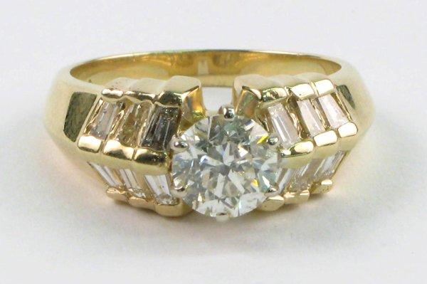 626: DIAMOND AND FOURTEEN KARAT GOLD RING, featuring ar