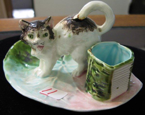 11: A MAJOLICA GLAZED POTTERY KITTEN MATCHHOLDER.  The