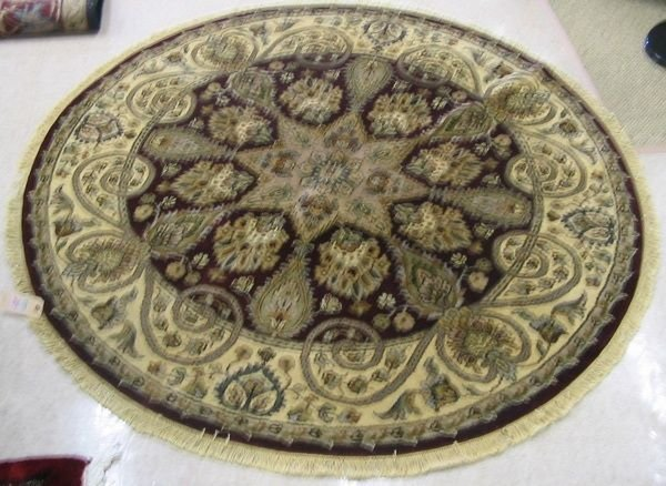 20: A ROUND ORIENTAL ACCENT RUG, Indo-Persian,  overall