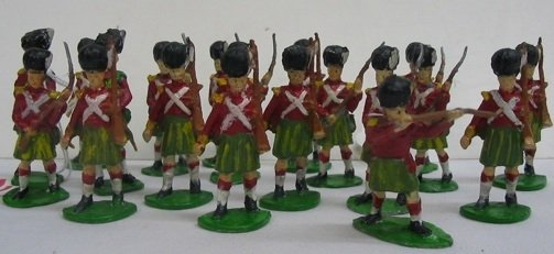 21: A GROUP OF 19 ENGLISH PAINTED METAL TOY SOLDIERS, i