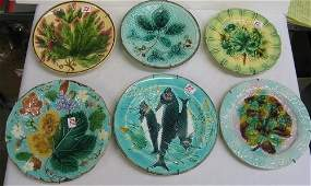 82 A COLLECTION OF SIX MAJOLICA GLAZED POTTERY  PLATES