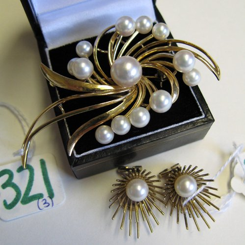 321: THREE ARTICLES OF PEARL AND FOURTEEN KARAT GOLD  J
