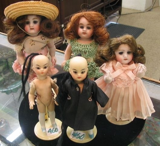 460: A GROUP OF FIVE ALL BISQUE DOLLS, including 3  Ger