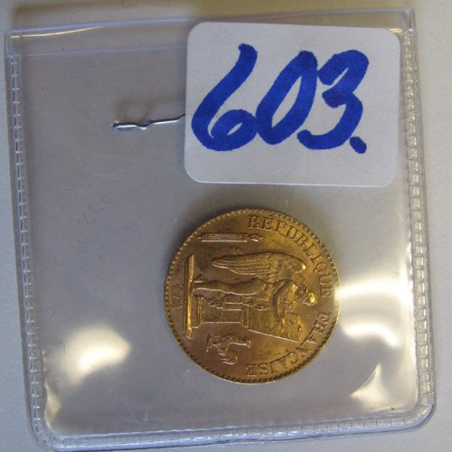 603: A FRENCH 20 FRANCS GOLD COIN dated 1897.