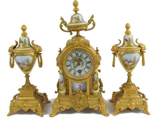 607: A FRENCH THREE-PIECE CLOCK SET. The gilt metal  fo