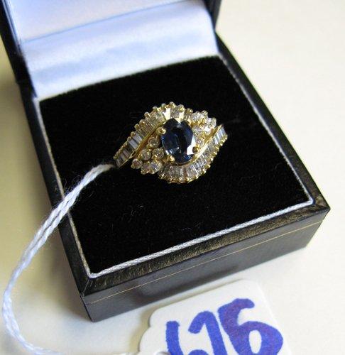 626: SAPPHIRE, DIAMOND AND FOURTEEN KARAT GOLD RING,  c