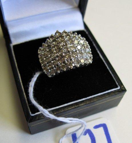 627: DIAMOND AND TEN KARAT YELLOW AND WHITE GOLD  CLUST