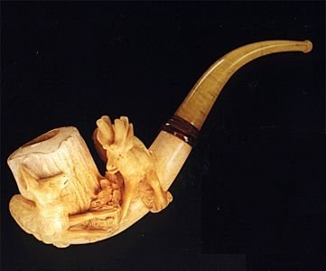 14: A GERMAN MEERSCHAUM HAND CARVED PIPE, the large smo