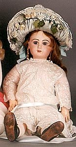 1003: FRENCH BISQUE HEAD DOLL, Jumeau type, brown wig,