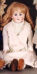 1022: GERMAN BISQUE SHOULDER HEAD DOLL, light brown wig