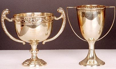 11: TWO STERLING DOUBLE HANDLED LOVING CUP TROPHIES; th