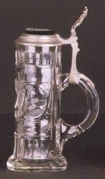 7: A GERMAN 1/2 LITER CLEAR GLASS BEER STEIN, hand cut