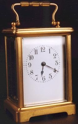 3: A FRENCH BRASS CASED CARRIAGE CLOCK, having beveled