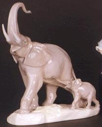 12: A COLLECTIBLE LLADRO FIGURE, mother elephant with b