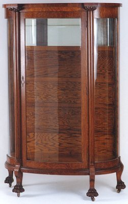 16: A CURVED GLASS AND OAK CHINA DISPLAY CABINET, Ameri