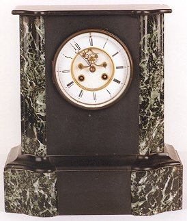 21: AN AMERICAN MARBLE MANTLE CLOCK, the curved front w