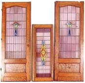 783: PAIR OF STAINED AND LEADED GLASS PARLOR DOORS WITH