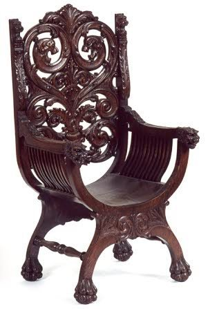 18: HIGHLY CARVED OAK ARMCHAIR, American, 19th century;