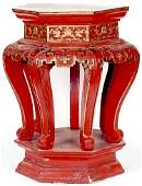 915 RED LACQUERED AND PARCELGILT WOOD PEDESTAL TABLE