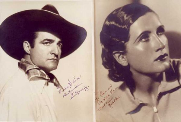 5: TOM AND MABEL MIX SIGNED PHOTOGRAPHS; a large black