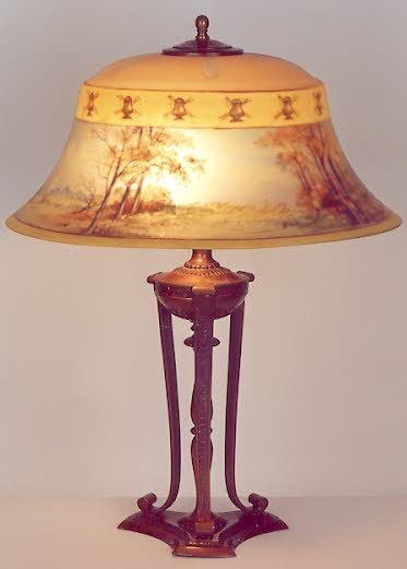826: A PAIRPOINT SIGNED TABLE LAMP. The tri-columned br