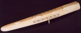 2: AN INNUIT WALRUS IVORY TUSK, hand carved as a cribba