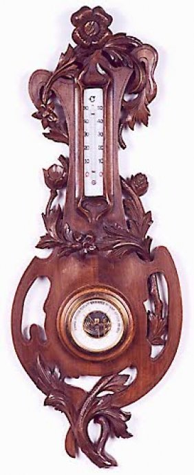 24: A FRENCH BAROMETER-THERMOMETER in hand carved-pierc