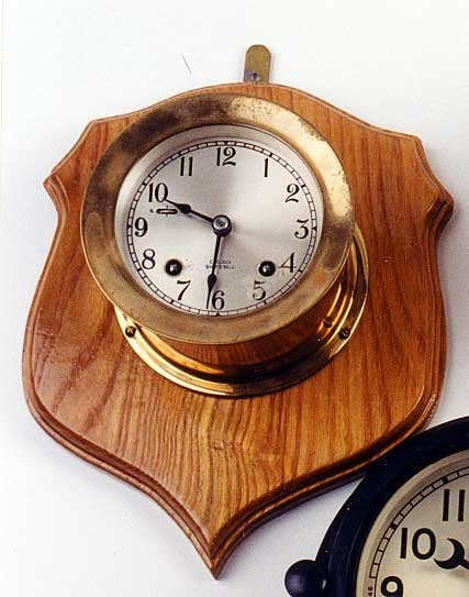 "9: A ""CHELSEA SHIP'S BELL"" CLOCK, the heavy brass deep"