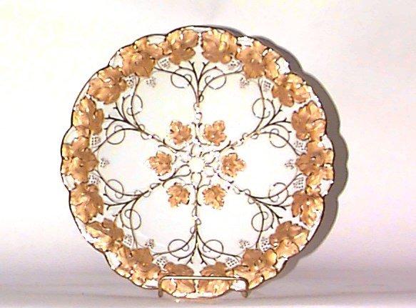 12: A MEISSEN PORCELAIN PLATE; molded with grape vines,