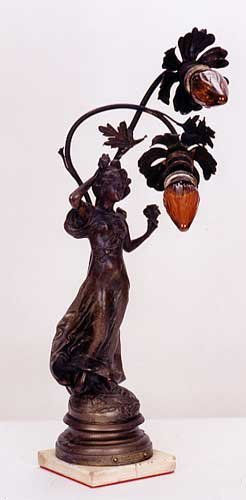 "8: A SPELTER FIGURAL TABLE LAMP, ""Fleur d'Avril"", the p"