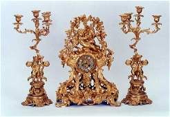 875 LOUIS XV STYLE THREEPIECE GILTBRONZE CLOCK SET
